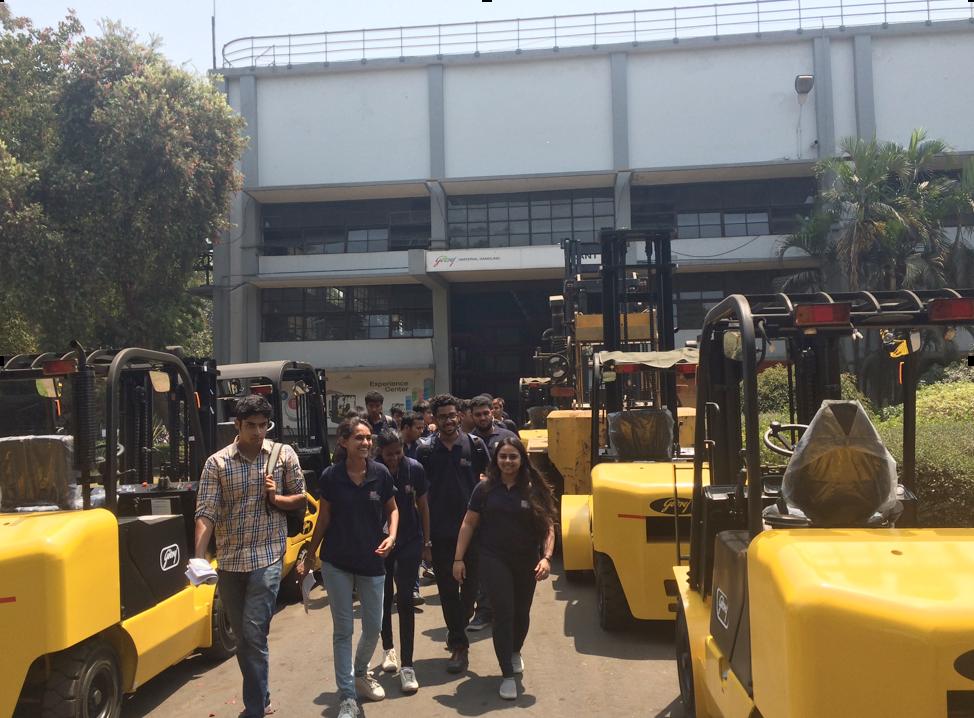 Jags tour the forklift area at Godrej & Boyce's plant near Mumbai
