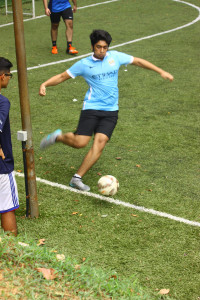Student dribbling the ball